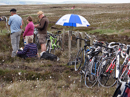 Parasol and bikes against the fence in Cragg Vale