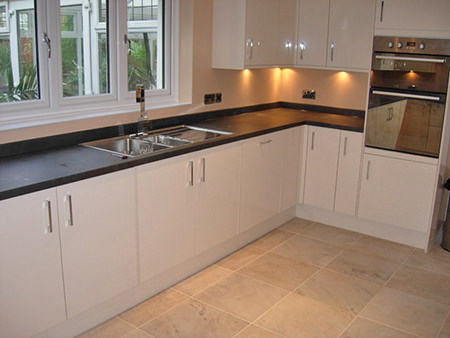 Cream fitted kitchen with tiled floor and underfloor heating