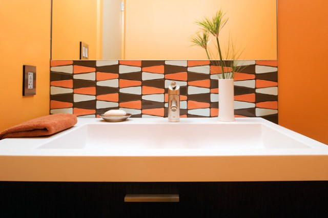Bathroom sink with splash back of triangular shaped tile splash back