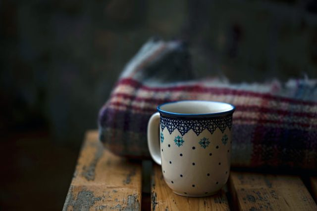 Woollen blanket and patterned pottery mug