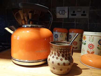 set of 3 vintage Worcester Ware storage tins with floral pattern with orange Kenwood kettle
