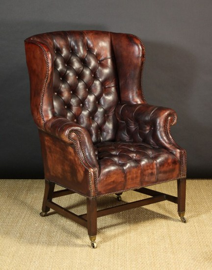 Antique leather Chesterfield armchair