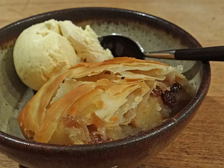 Bowl of home-made apple & sultana strudel with ice cream | H is for Home