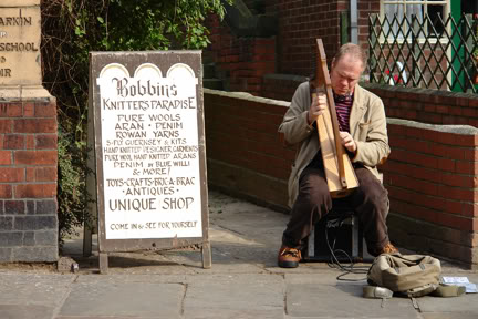 Busker playing the harp on Church Street, Whitby | H is for Home