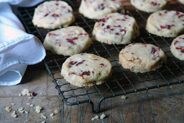Home-made macadamia nut & cranberry cookies on a wire cooling rack | H is for Home