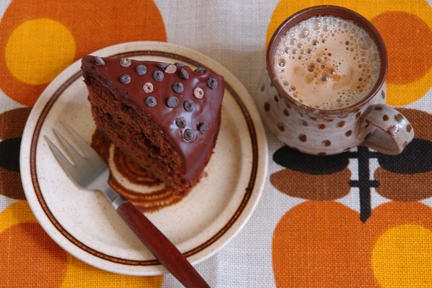 Slice of home-made mocha fudge cake with mug of coffee | H is for Home