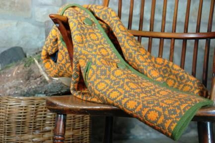 Vintage orange & green Welsh wool coat on stick back chair