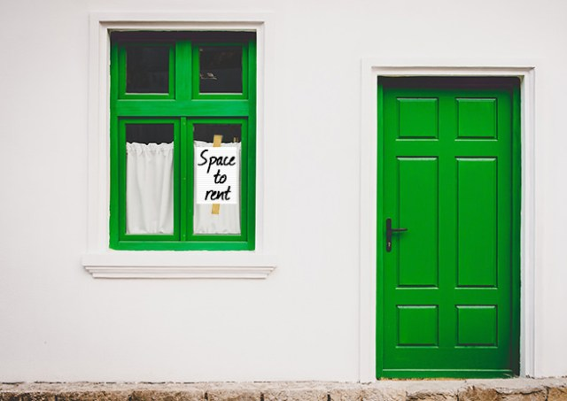 'Space to let' sign in a green window