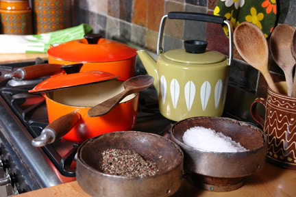 Antique wooden cheese moulds being used as stove-side salt & pepper pinch pots   H is for Home