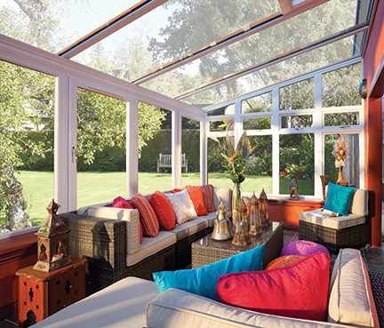 sun lounge with sofas and colourful cushions