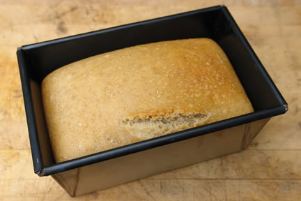 Freshly-baked sourdough loaf still in its tin | H is for Home