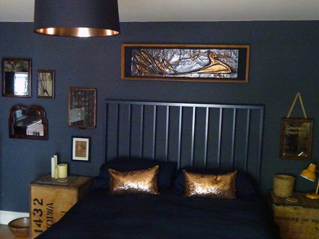 Vintage beaten copper plaque above the bed in our top-floor bedroom | H is for Home