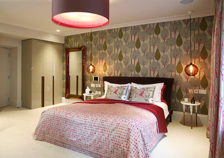 colourful bedroom with tree patterned wallpaper