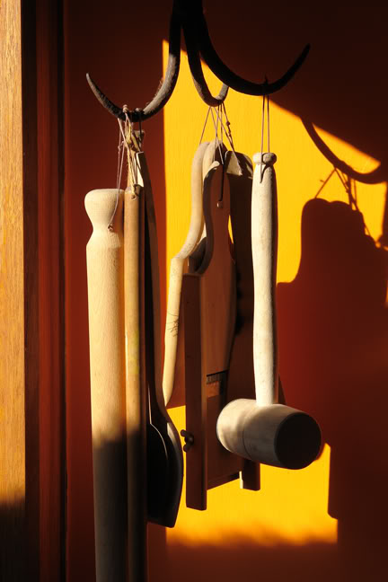 group of utensils hanging from antique iron well hook | H is for Home