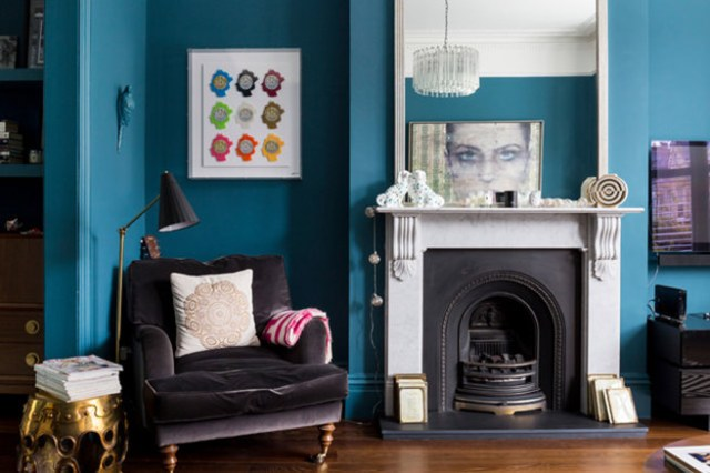 Victorian living room with blue painted walls and period Victoria fireplace