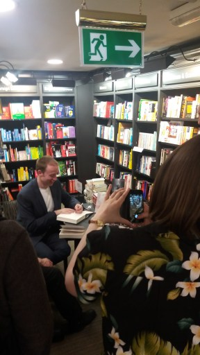 Juliet Mushens attempting to photo Pete whilst signing...