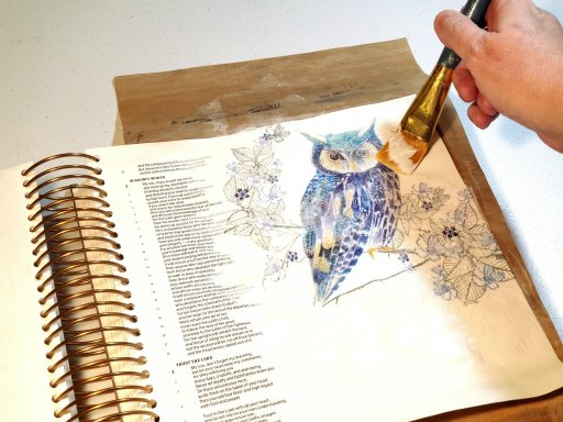 blue and purple owl on Bible page using napkin decoupage