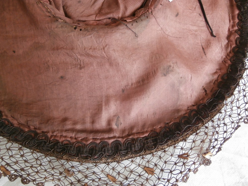 Old rose silk lining and dyed, decorative string attached to brim