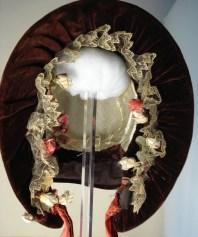 Front view of flower and lace trim bonnet, 1840s bonnet, Snowshill Collection