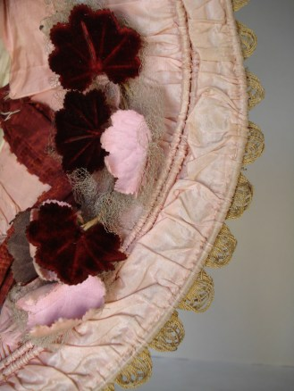 Detail of dawn-pink taffeta ruched over three rows of cane, 1840s bonnet.