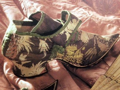 1720s purple brocade shoes, Killerton Costume Collection. Image taken from Jane Ashelford's The Art of Dress', 1996.