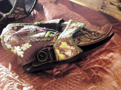 1720s purple brocade shoe and leather clogs, Killerton Costume Collection. Image taken from Jane Ashelford's The Art of Dress', 1996.