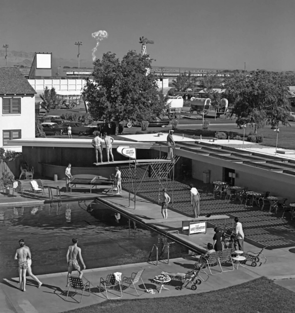 Guests at a Las Vegas hotel watch a mushroom cloud from an atomic test 75 miles away, 1953.