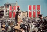 Adolf Hitler salutes troops of the Condor Legion who fought alongside Spanish Nationalists in the Spanish Civil War, during a rally upon their return to Germany, 1939.