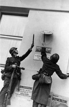 German soldiers removing Polish government insignia.