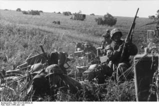 German motorized troops prepare to move out.