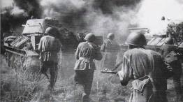 Soviet troops follow their T-34 tanks during a counterattack.