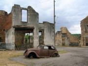 Burned out cars and buildings still litter the remains of the original village in Oradour-sur-Glane, as left by Das Reich SS division.
