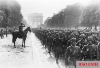 German soldiers march near the Arc de Triomphe in Paris, 14 June 1940.