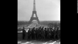 Paris under the Occupation. German soldiers on the Trocadero esplanade admiring the Eiffel tower.
