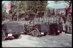 German victory parade in Warsaw after the invasion of Poland, 1939. (Hitler is on platform, arm raised in Nazi salute.)