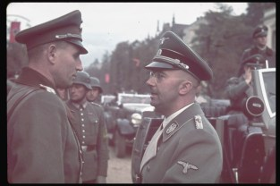 Head of the SS Heinrich Himmler (right), one of the chief architects of the Holocaust, speaks with an unidentified officer in Warsaw after German invasion of Poland, 1939.