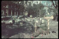 Warsaw citizens buried their dead in parks and streets after the invasion of Poland, 1939.