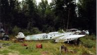 """The sad remains of a Messerschmitt Bf 110 G-4 """"3G+DR"""" of 7.Staffel/NJG 4. The photograph was taken in the summer of 1945 at Reims in France after the Battle of Normandy."""