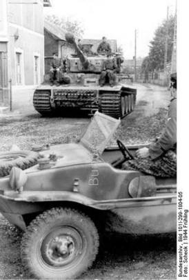 "Tiger I ""(tower number 133) of the first SS-Panzer-Korps ""Leibstandarte Adolf Hitler"" in town before business ""Nieuverburg"" in the foreground floating bucket, PK 698 during the Normandy invasion."
