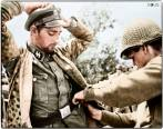 Soldat of the 2.SS-Panzer-Division 'Das Reich' being searched by a US soldier after surrender.