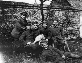 Hitler (far right, seated) with his army comrades of the Bavarian Reserve Infantry Regiment 16 (c. 1914–1918).