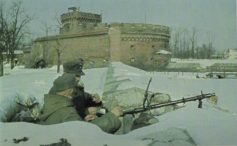 A lone two-man MG34 machine gun team in their snow-covered foxhole amidst the old fortifications of Königsberg await the Soviet onslaught in early 1945.