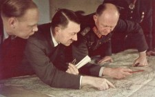 Adolf Hitler & Alfred Jodl analyzing a map.