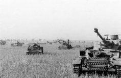 Panzer IIIs and IVs advance against the southern face of the salient