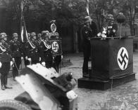 Parade for the third anniversary of the Leibstandarte SS Adolf Hitler on the barracks' grounds. Sepp Dietrich is at the lectern. May 1935.