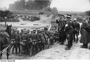 Hitler reviews troops on the march during the campaign against Poland. September 1939.