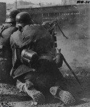 German MG squad in action, with MG-34 on a gun carriage.
