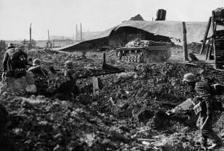 Engineers advancing in Stalingrad with a Stug III Assault Gun.