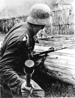 German soldier with the 24 handle hand grenade