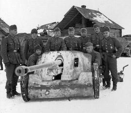 Group portrait of soldiers with their PAK 50mm in the snow.